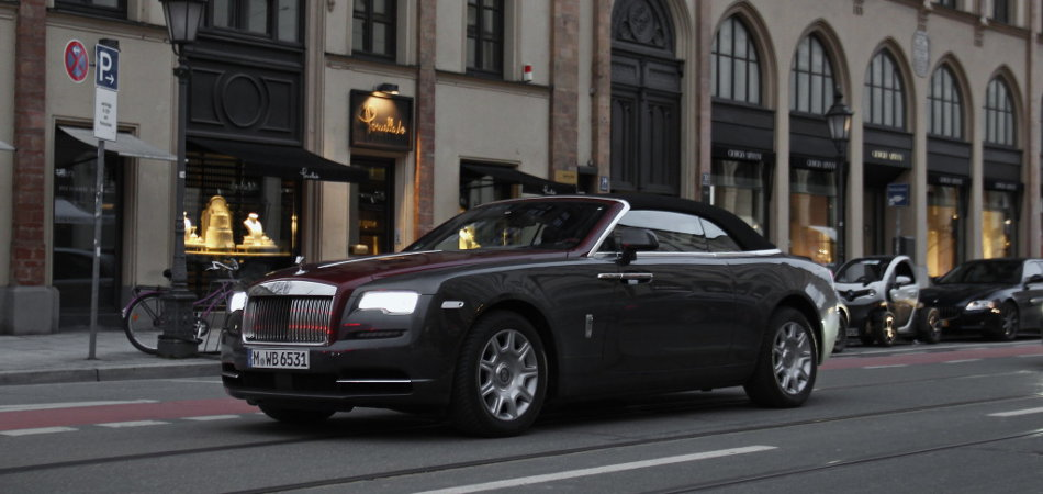 2016 Rolls-Royce Dawn Driving Near Store Fronts
