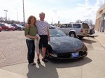 Happy Couple with a 2001 Corvette!