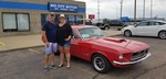 HAPPY CUSTOMERS WITH A NEW MUSTANG